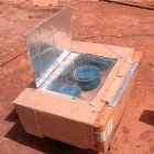 A similar solar cooker. Both use reflective properties to harness the sun's rays