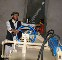 A technician switches on the Dodarak Micro-Hydropower Plant for the first time.