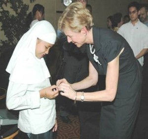 US Ambassador Kristie Kenney gives 12-year old Saima Badule at a gift in celebration of the AMORE project. Saima's elementary school in the village of Kabuling in Pandag, Maguindanao was one of the over 200 that were electrified.