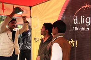 Demonstrating a D.Light Nova lamp at a stall in Chamieyani, India